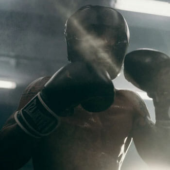 sweaty man in a middle of a boxing match