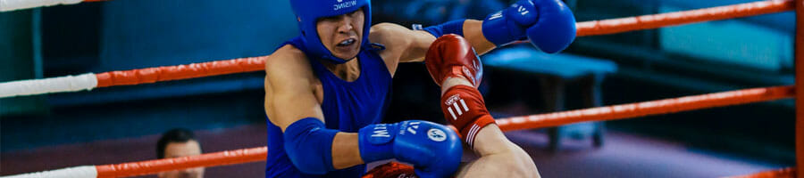 men wearing boxing gears in a boxing match