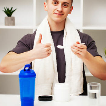 man approving his protein shake