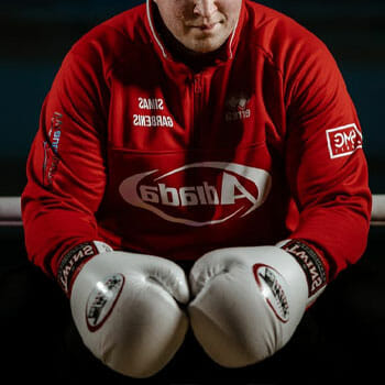 man in a red shirt with boxing gloves