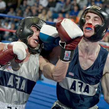 men fighting for a boxing title