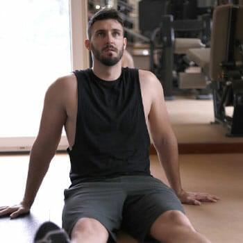 man sitting down in a gym