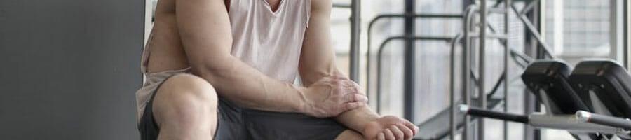 man holding wrist