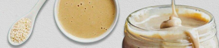 tahini on spoon, bowl and a jar