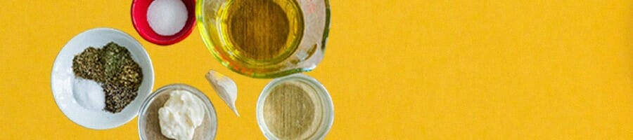 Oil free vegan salad dressing on a yellow background