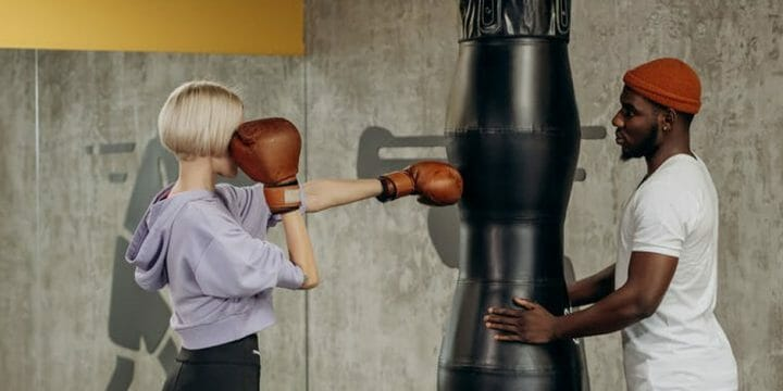 building muscles with a punching bag