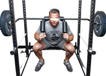 man lifting a heavy barbell with a machine