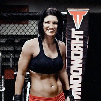 Professional UFC fighter smiling inside the ring