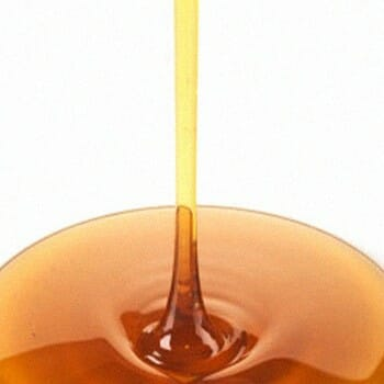 Maple syrup being poured in a flat surface