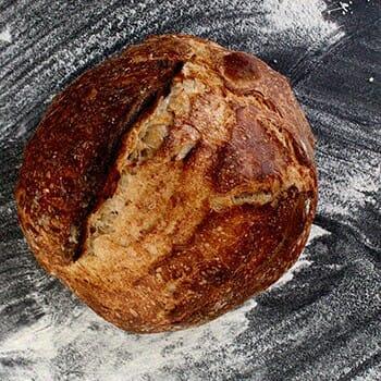 Sourdough bread with flour surrounding it