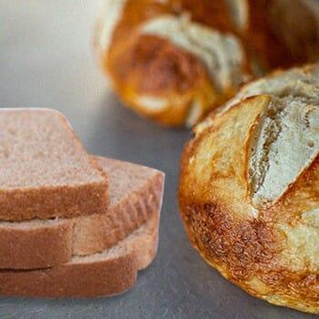 A sourdough beside a regular bread