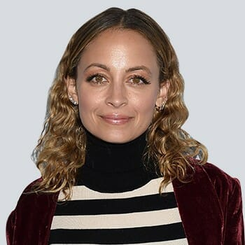 Nicole Richie smiling in front of the camera
