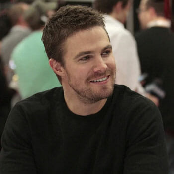 portrait image of Stephen Amell in a black shirt