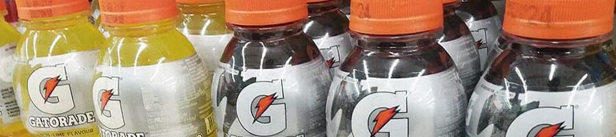 A collection of two different flavors of a sports drink