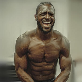shirtless antonio brown flexing his muscles