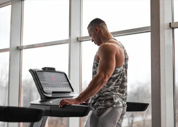 man working out in a treadmill