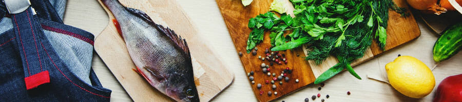 fish and green on a chopping board