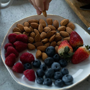 plate full of fresh fruit and nuts