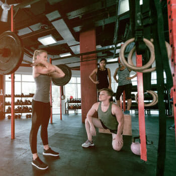 friends doing cross fit exercise together