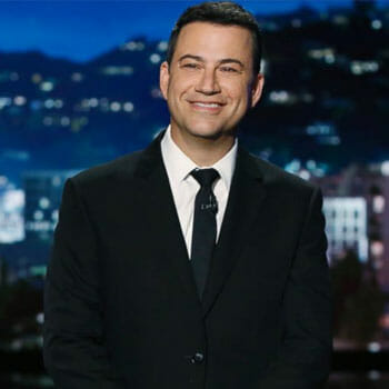 portrait image of a smiling jimmy kimmel on during a tv show