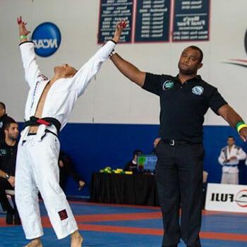 man raising a winners arm