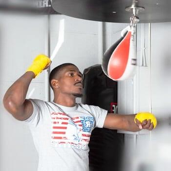 black man punching using a speed bag
