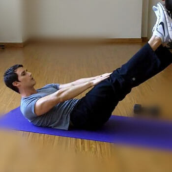 man laying down in a yoga mat doing V ups