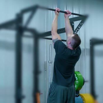 man in a chin up position