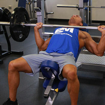 man in an incline bench press position