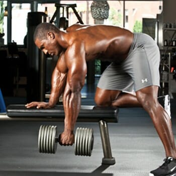 man in a single arm dumbbell row position