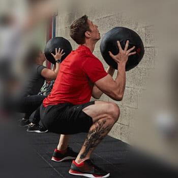 man using a medicine ball to workout