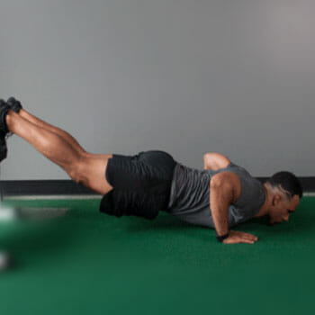man in a push up position