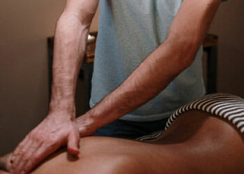 man doing a massage to a person