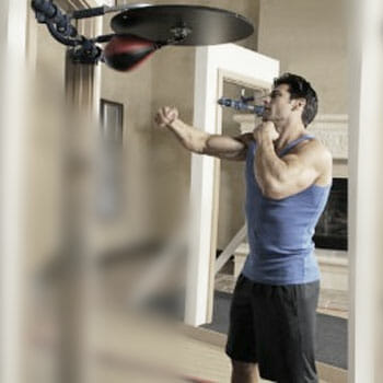 man working out with a speed bag at home