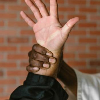 man grabbing another's wrist