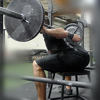 man doing weightlifting while sitting down