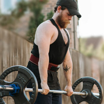 man doing deadlifts outdoors
