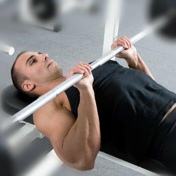 man doing a close grip bench press