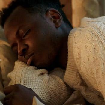 close up image of a man sleeping