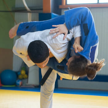 men practicing judo by dueling