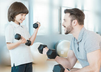 man with his son inside a gym