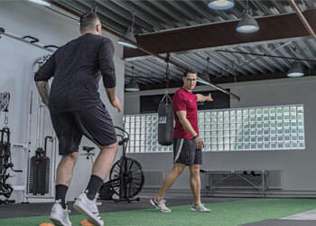 man working out with a trainor