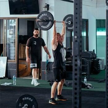 man weightlifting inside a gym