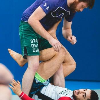 men learning judo take down
