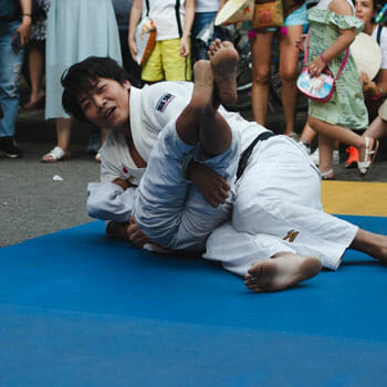 men in a middle of a judo match