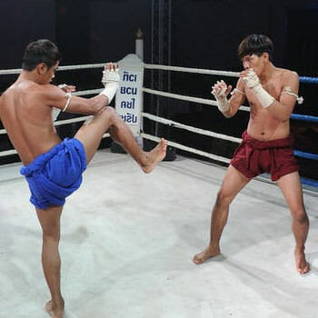 athletes in a middle of a muay thai match