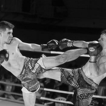 men athletes during their kickboxing match