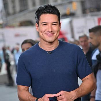 mario lopez wearing a blue sweatshirt outdoors