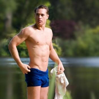 alexander dreymon beside a river, shirtless