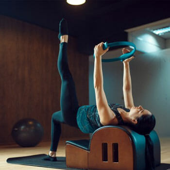 female working out with pilates training